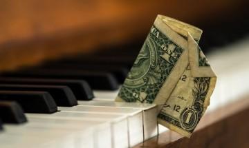 como ganar dinero con musica